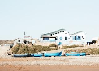 blue boats docked near the seashore