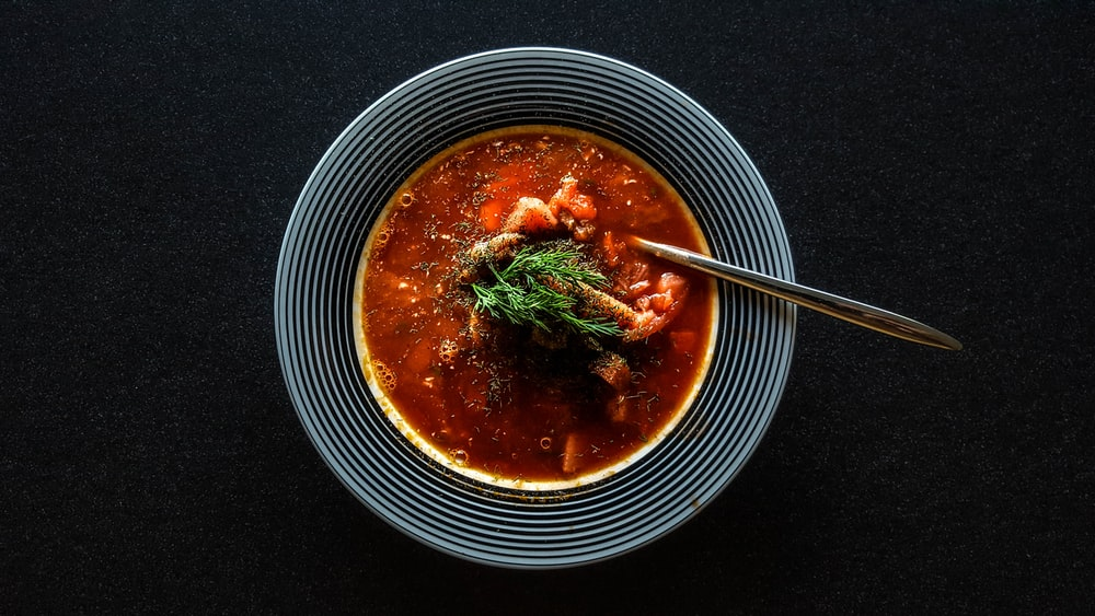 soup with vegetable on gray bowl