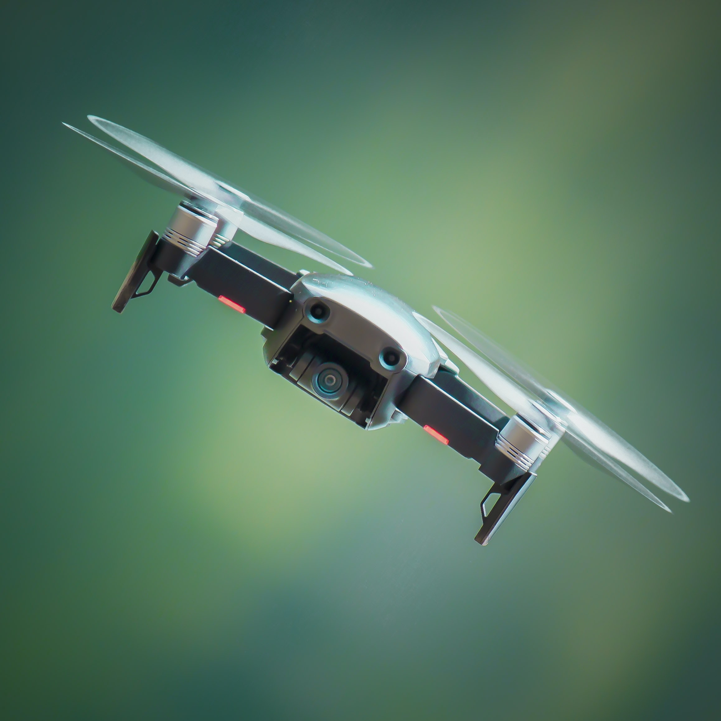 selective focus photography of gray and black quadcopter drone