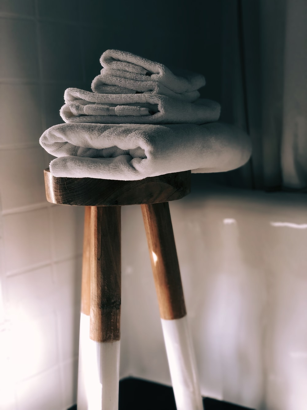 white towels on brown wooden stool