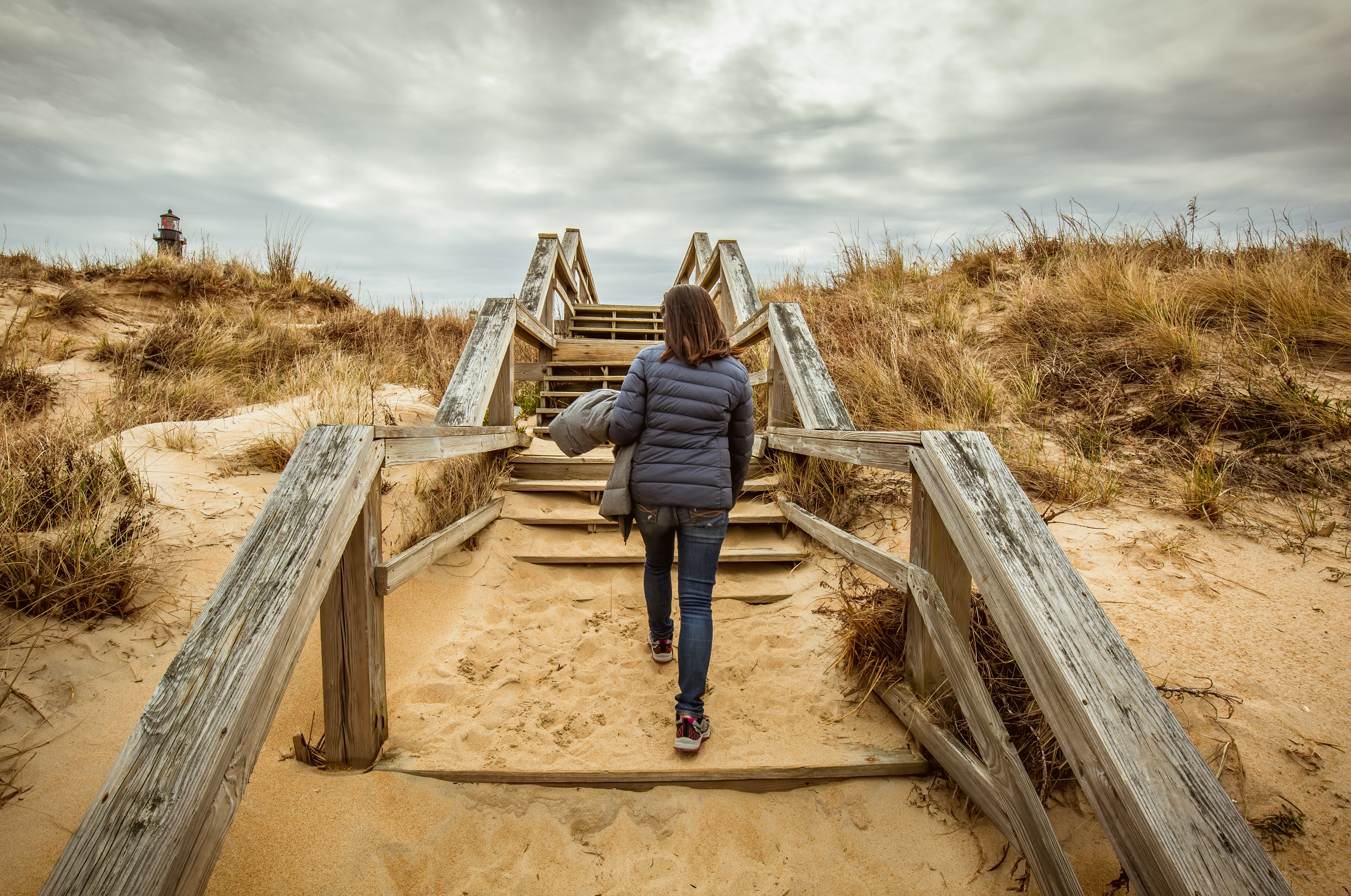 woman walking on stairs during daytime
