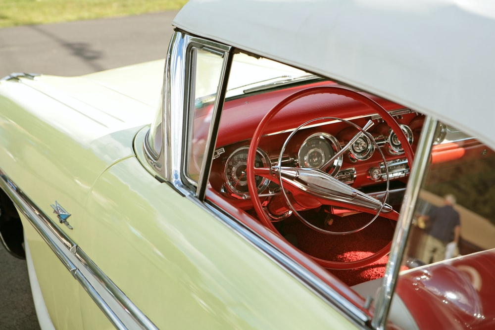 classic beige car with red interior