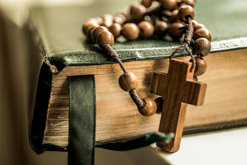 brown tesbih prayer beads on black book