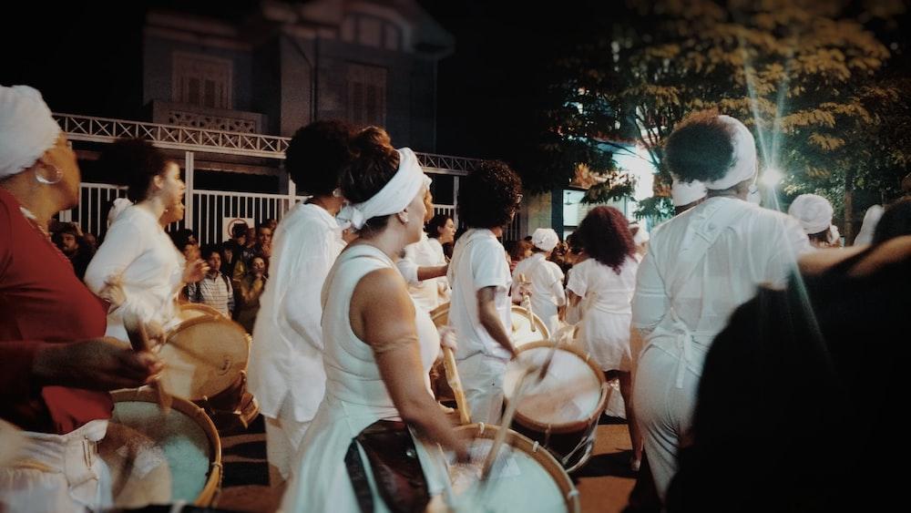 people parade during nighttime