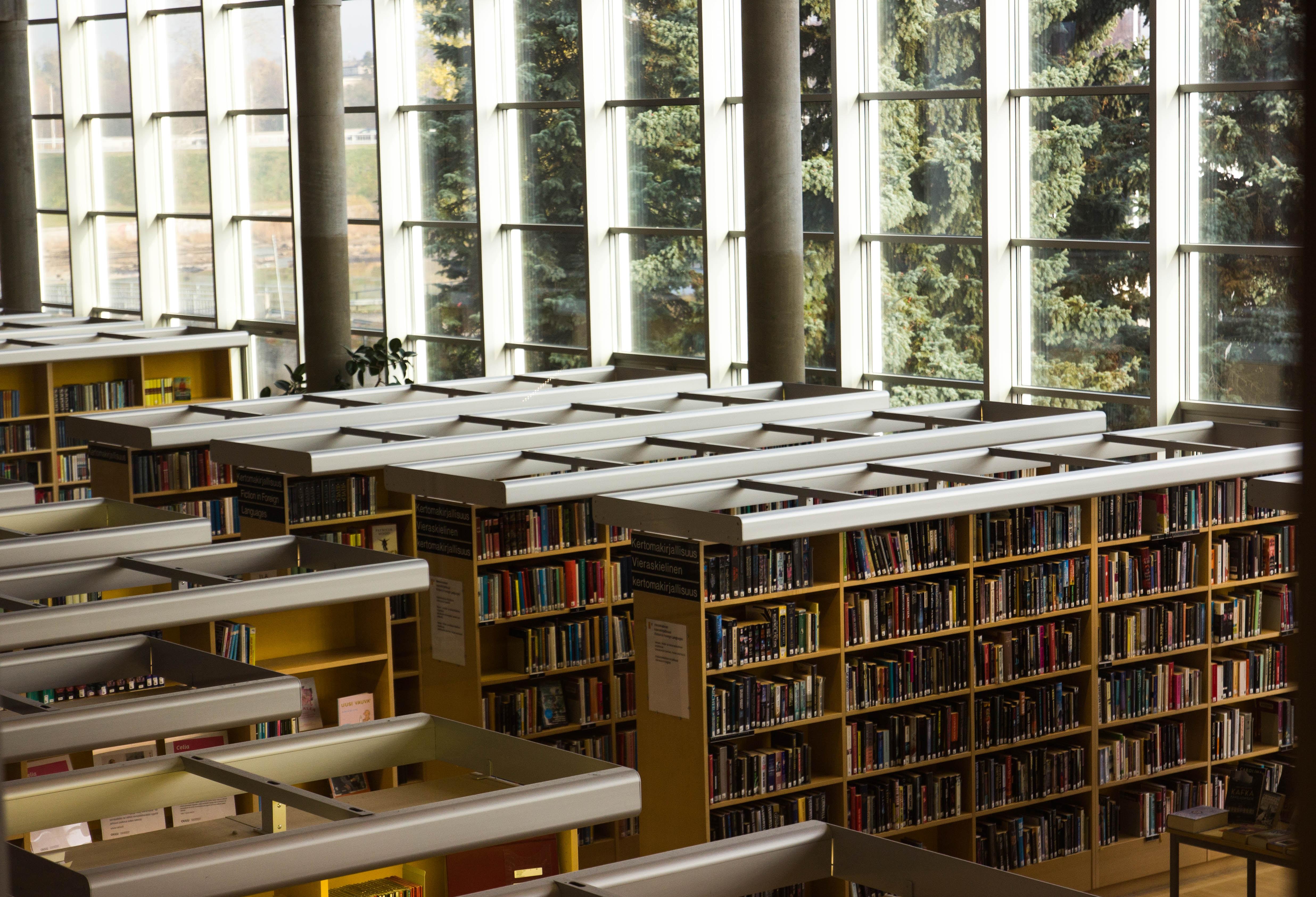 brown wooden bookshelves during daytime