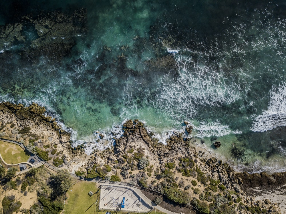 aerial photography of body of water beside island