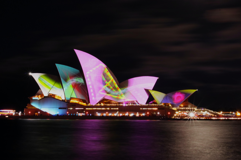 lighted Sydney Opera House at night