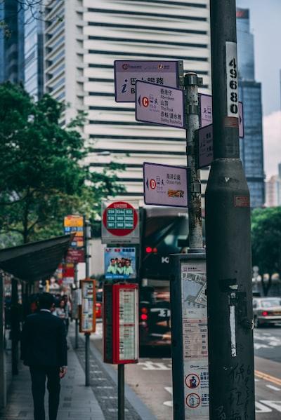 man walking near road signage