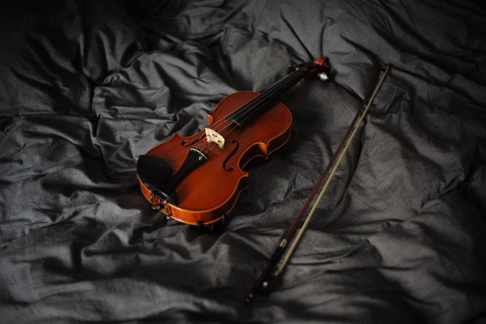 violin with bow on cloth