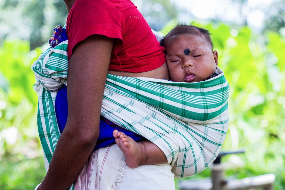 person carrying a baby