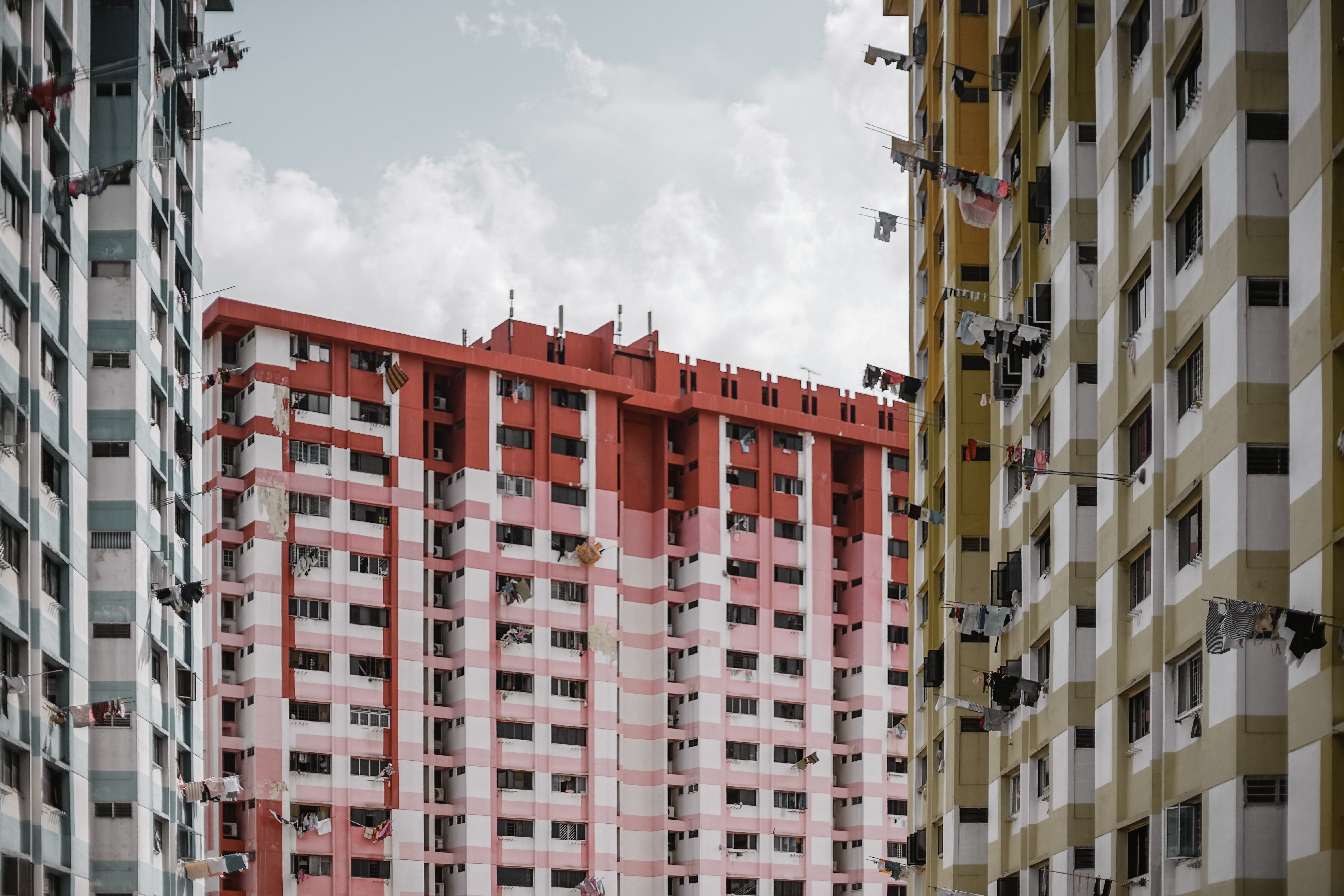 three white, red, and brown high-rise buildings