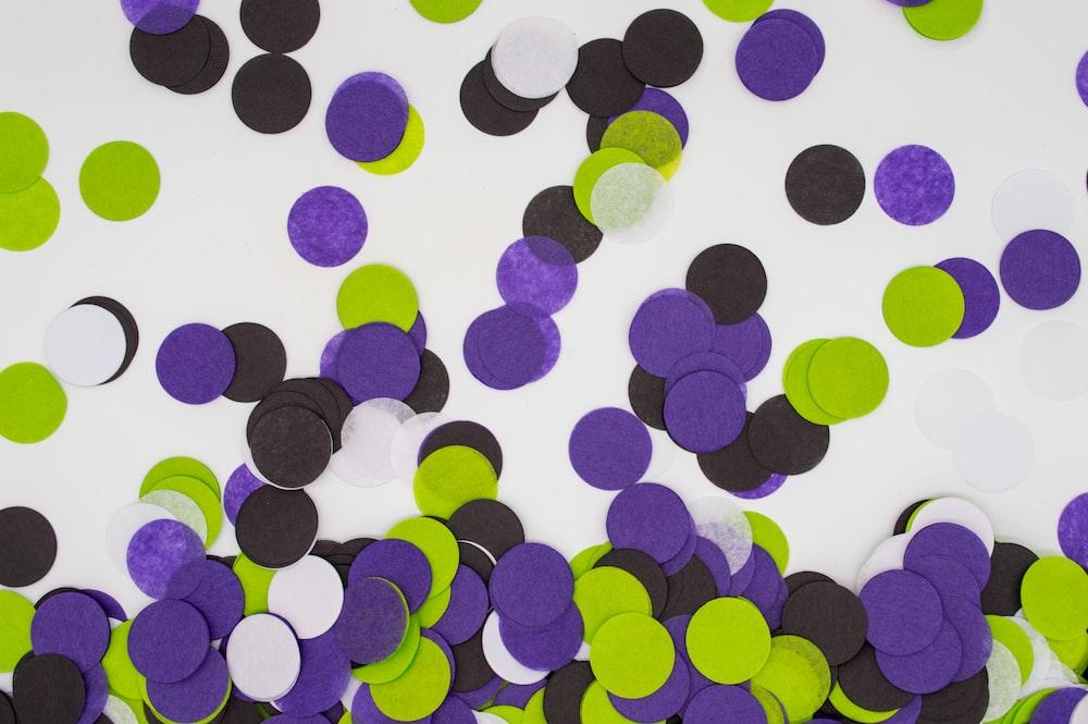 round purple, black, green, and white paper cuts