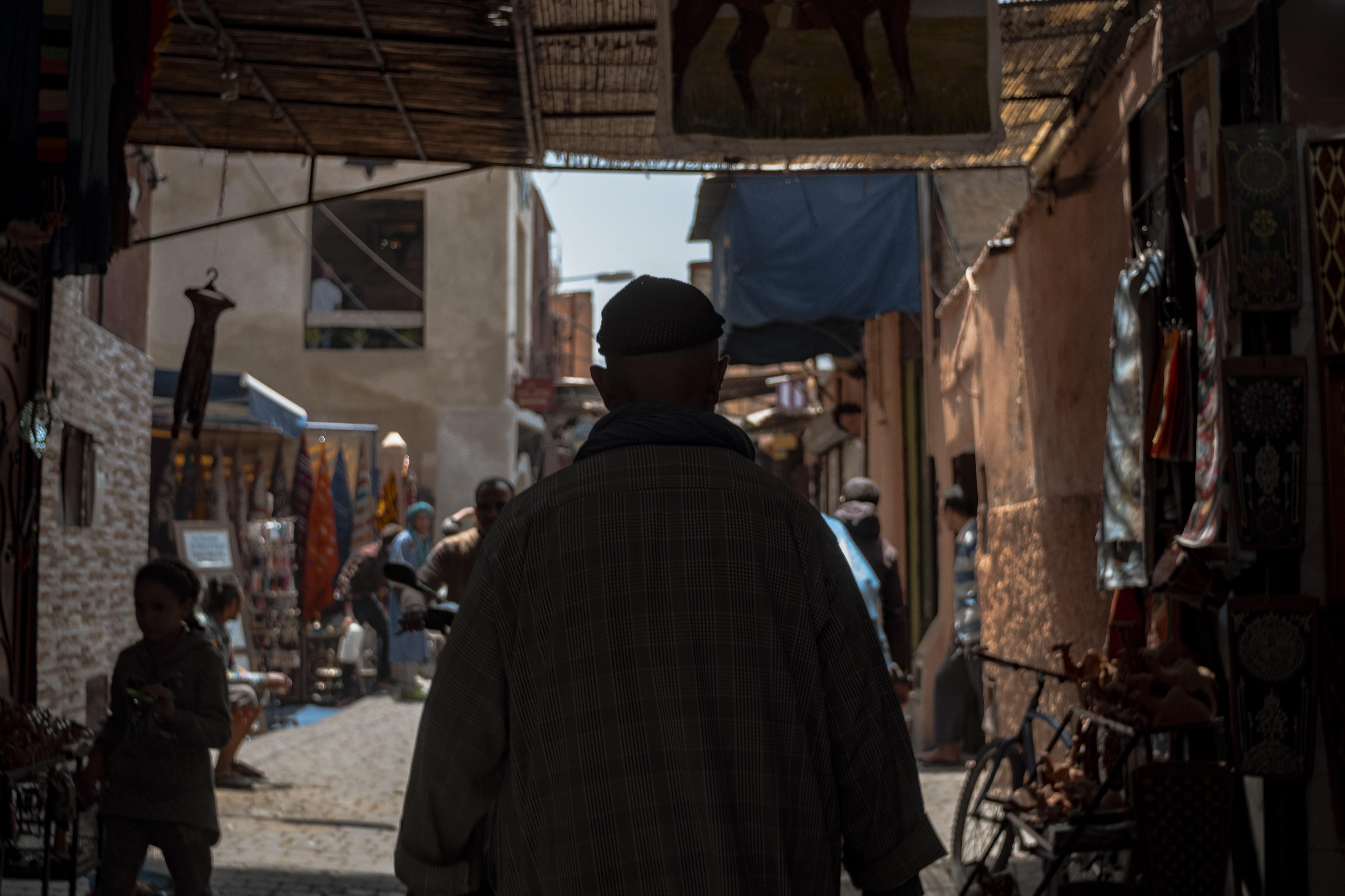 man walking on pathway