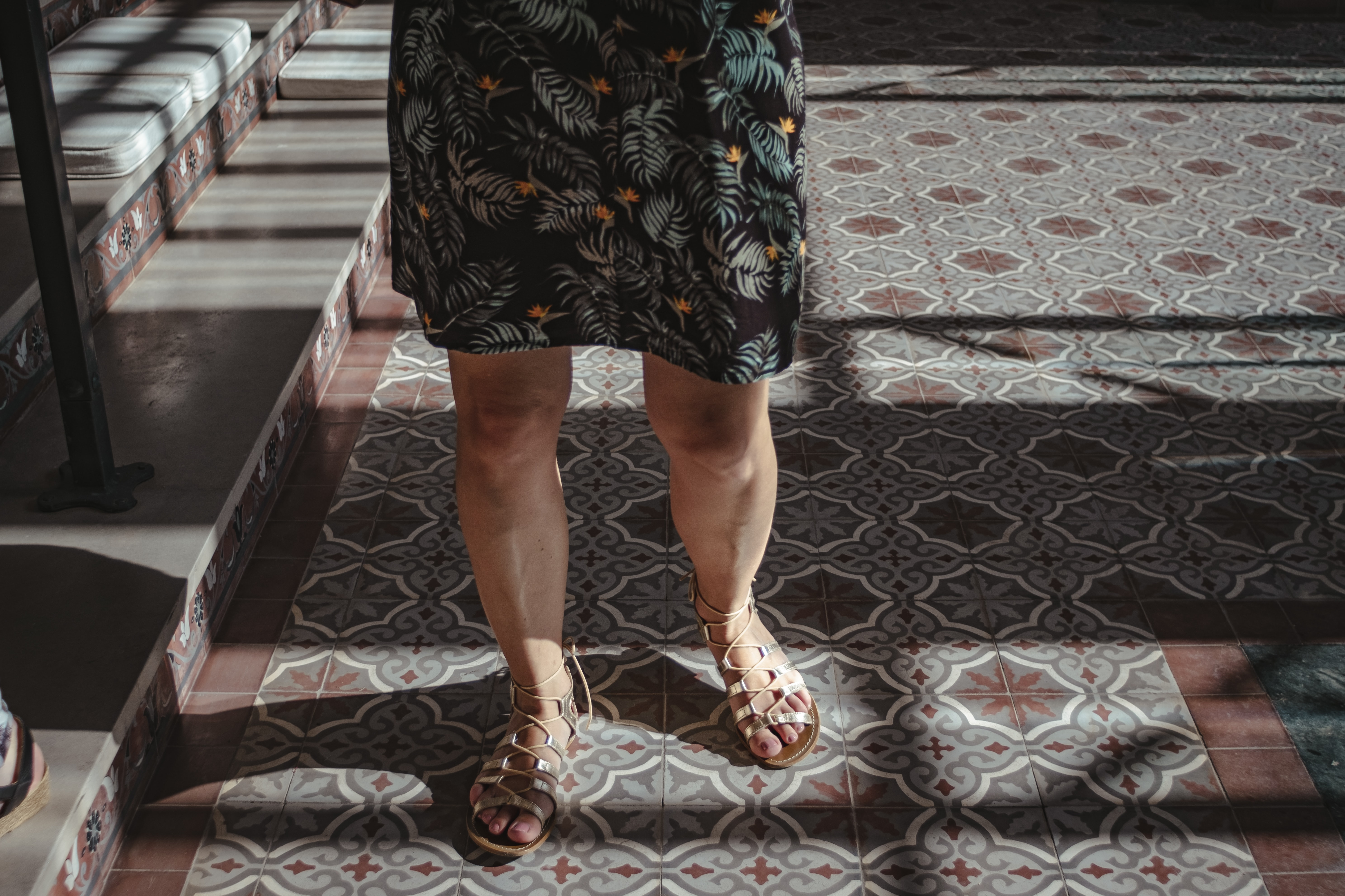 person wearing brown leather gladiator sandals