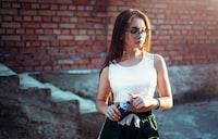 woman holding Pepsi bottle