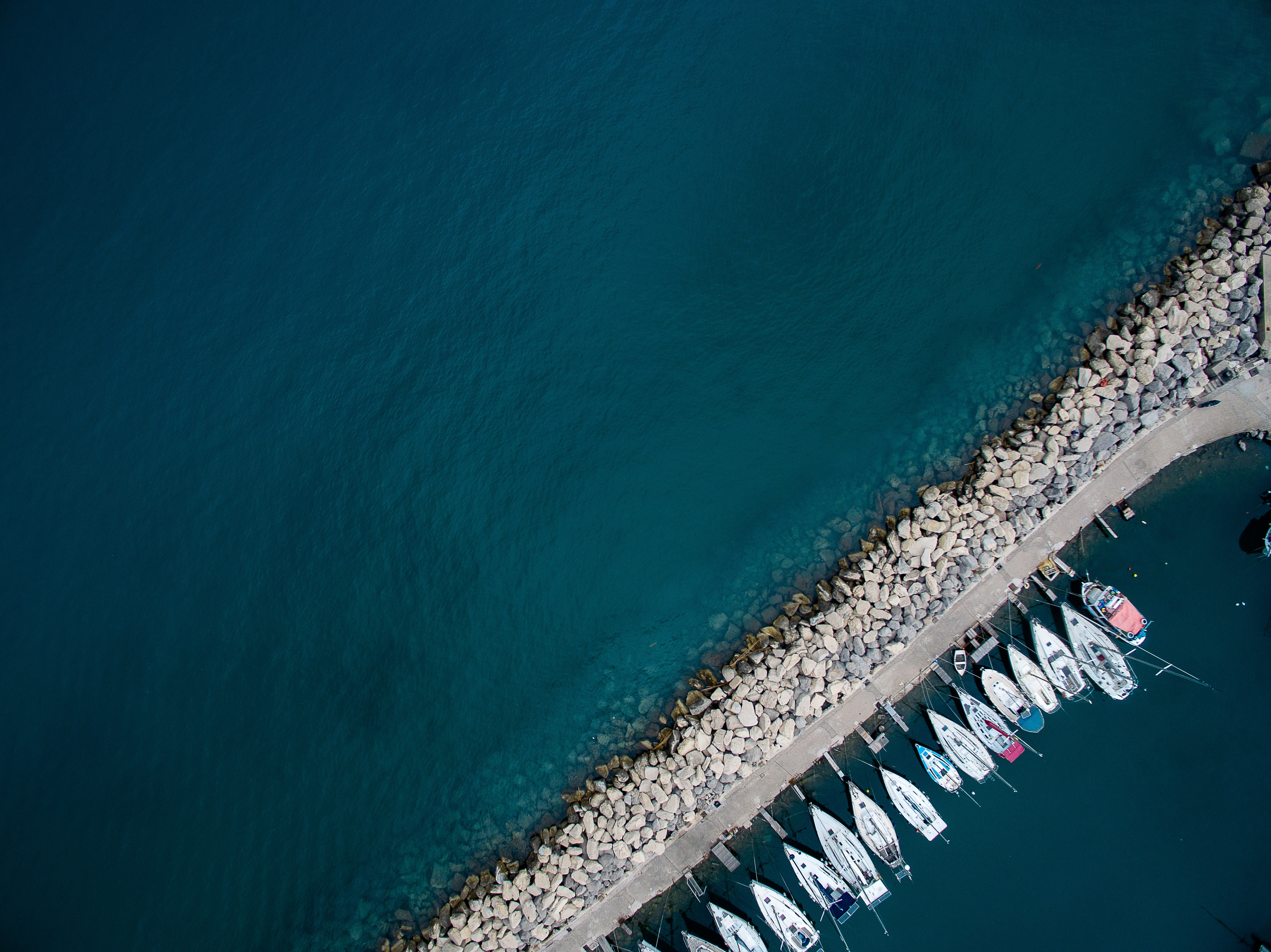 aerial photo of boats docked on pier