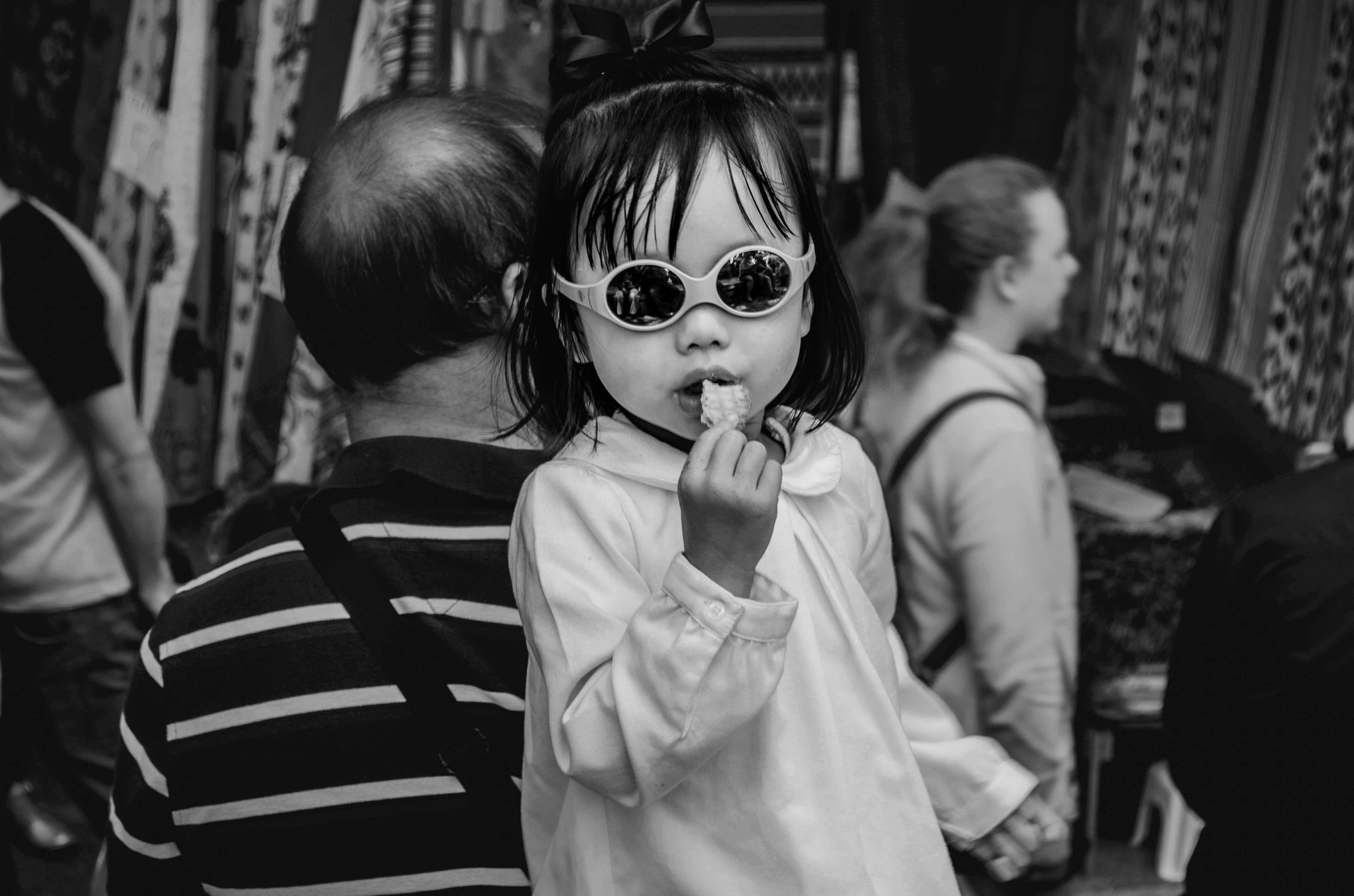 greyscale photo of child eating