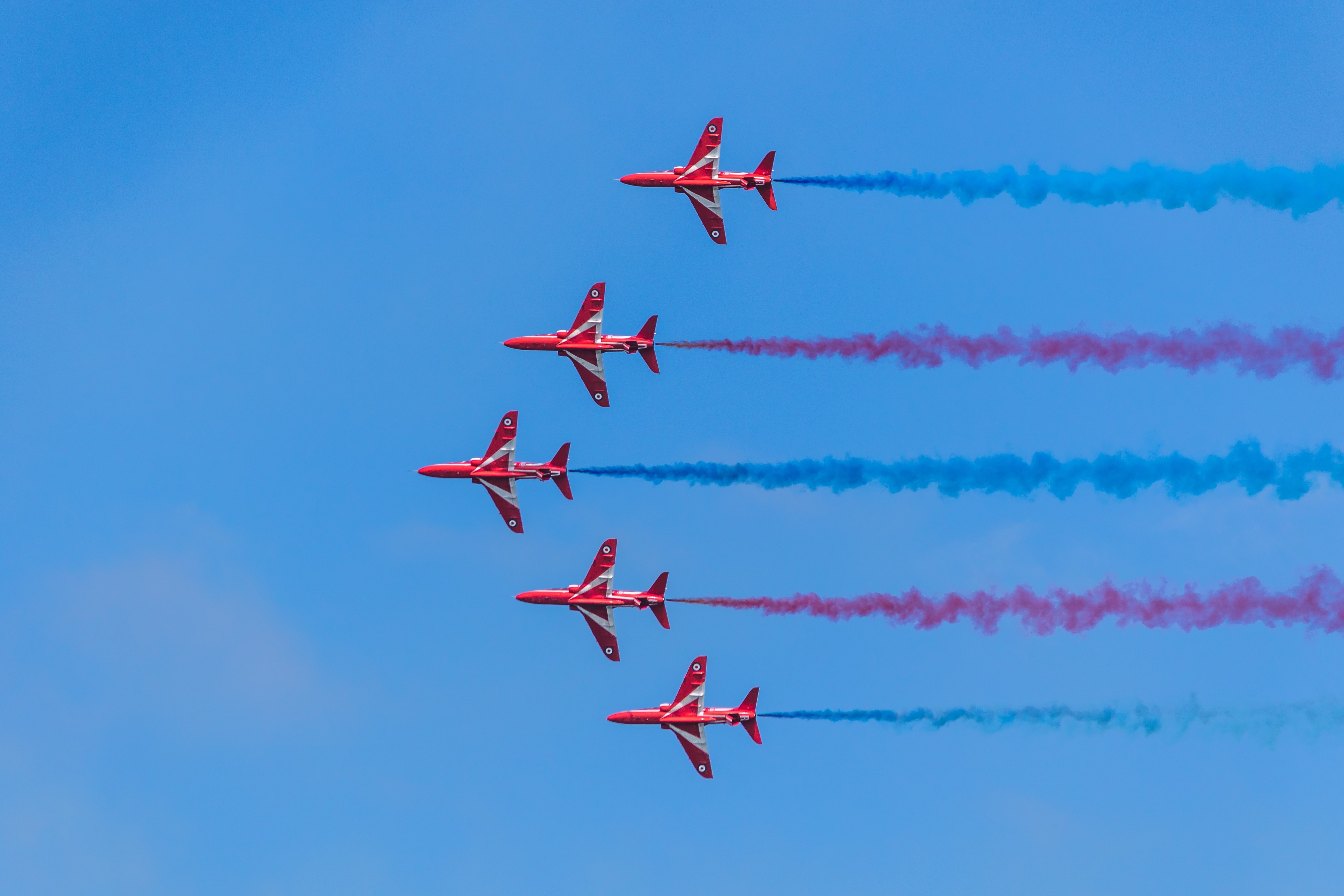 five red planes in sky