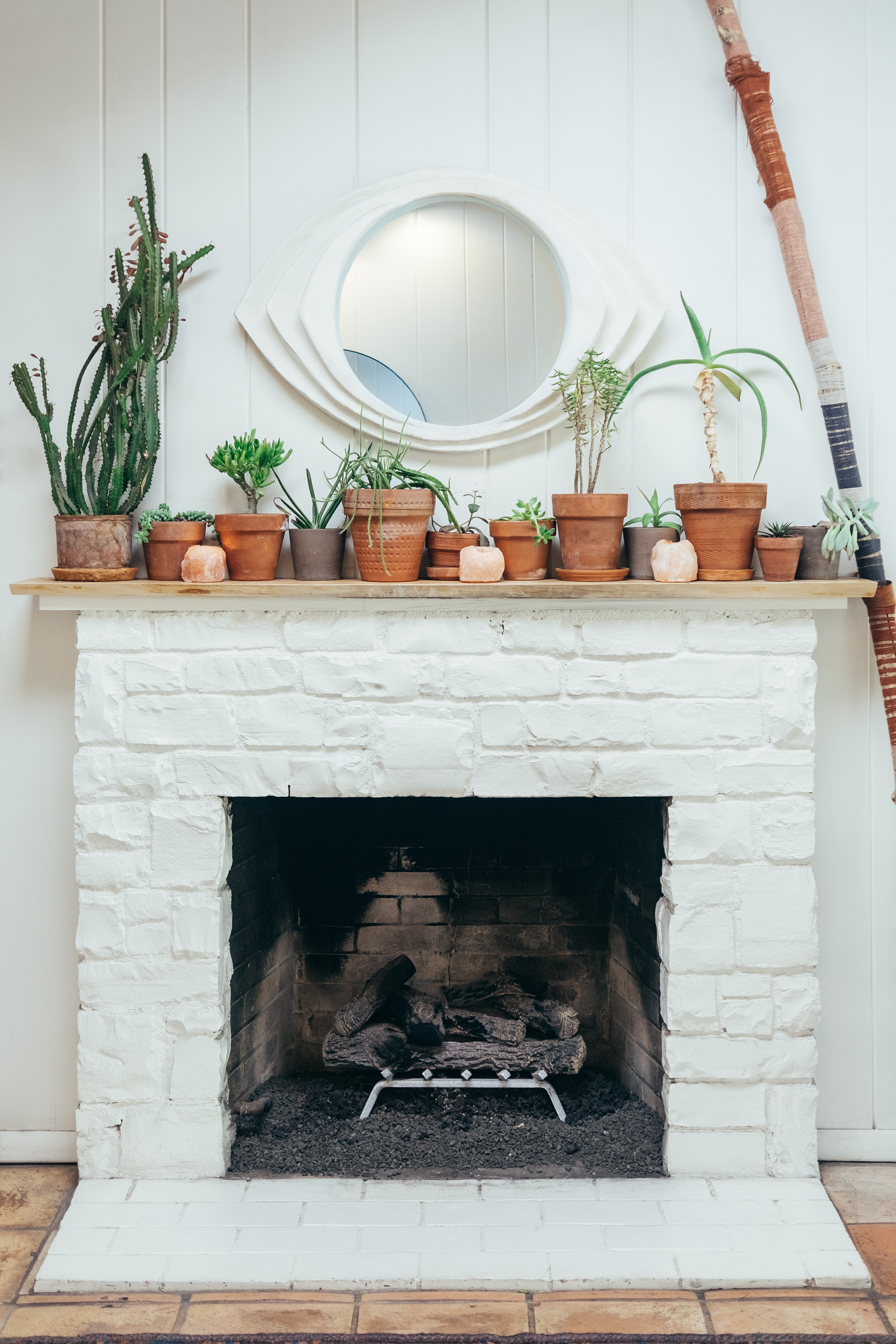 assorted pots on top of white fireplace