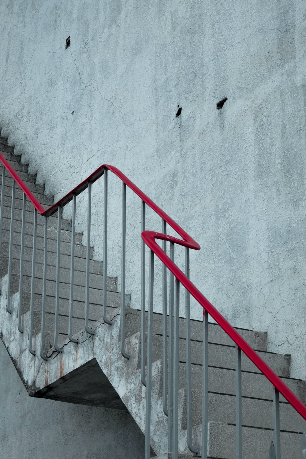 grey and red metal rail stair