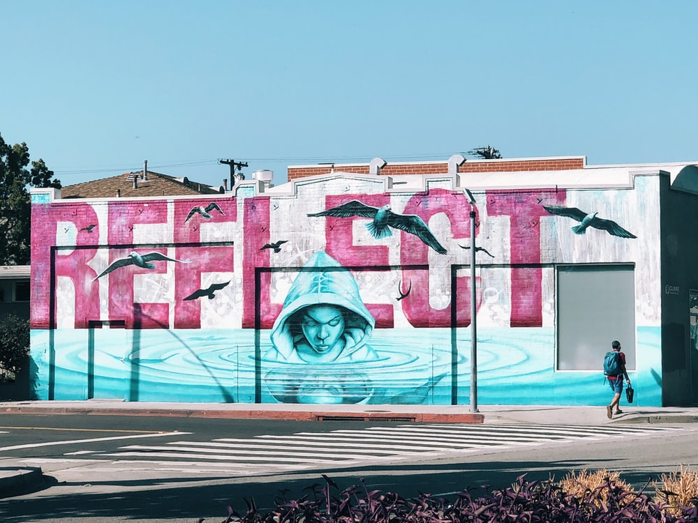 reflect text person with hoodie mural painting