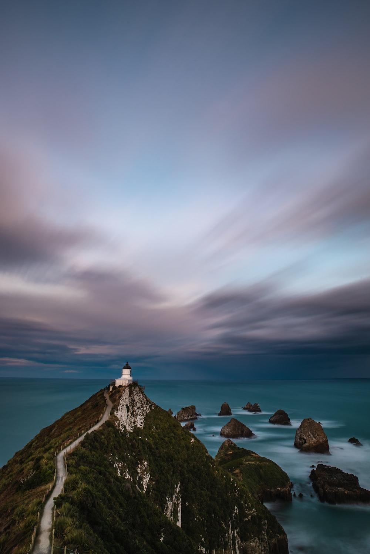 lighthouse on top of mountain peak