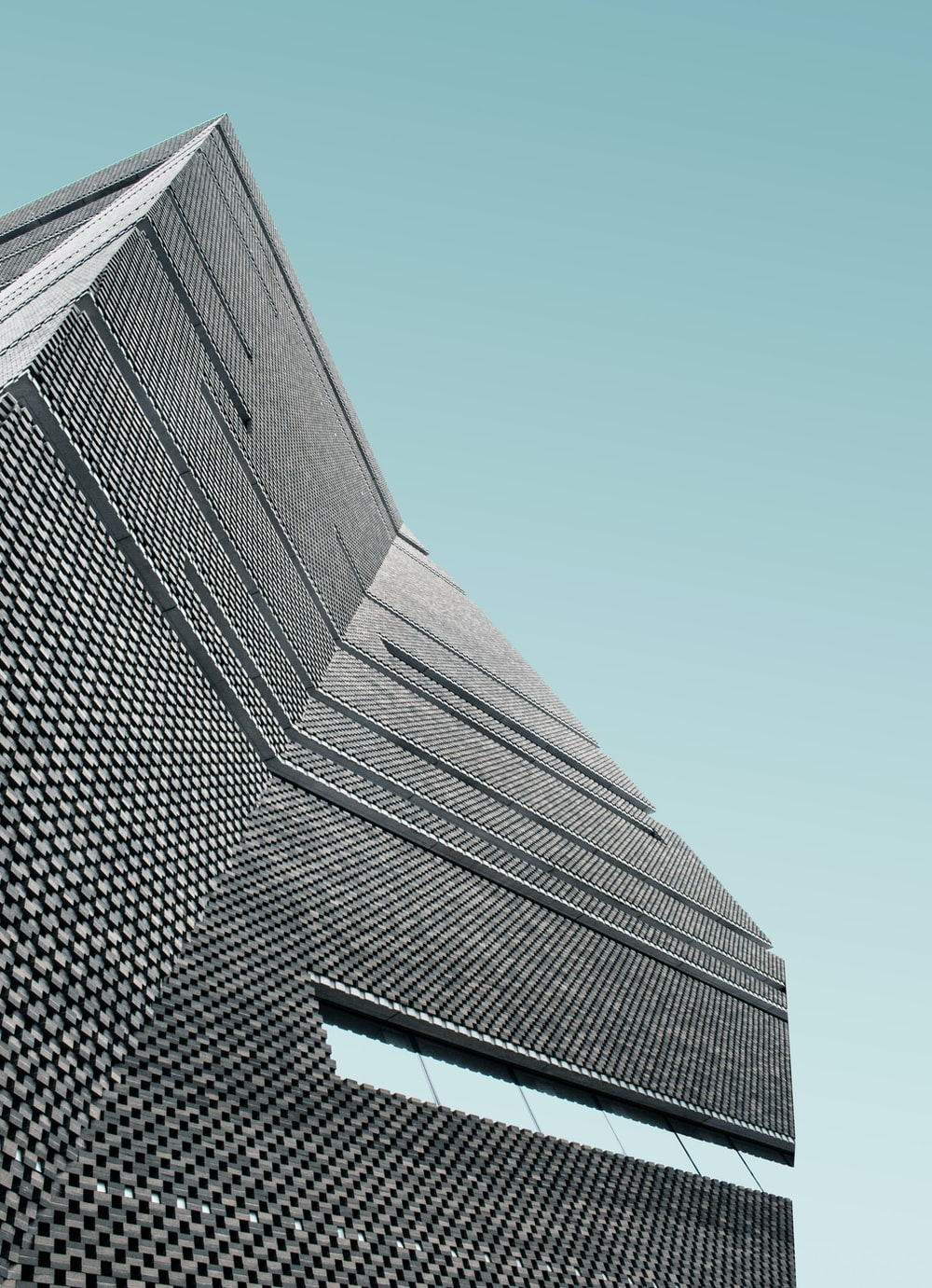 low angle photo of curtain wall building