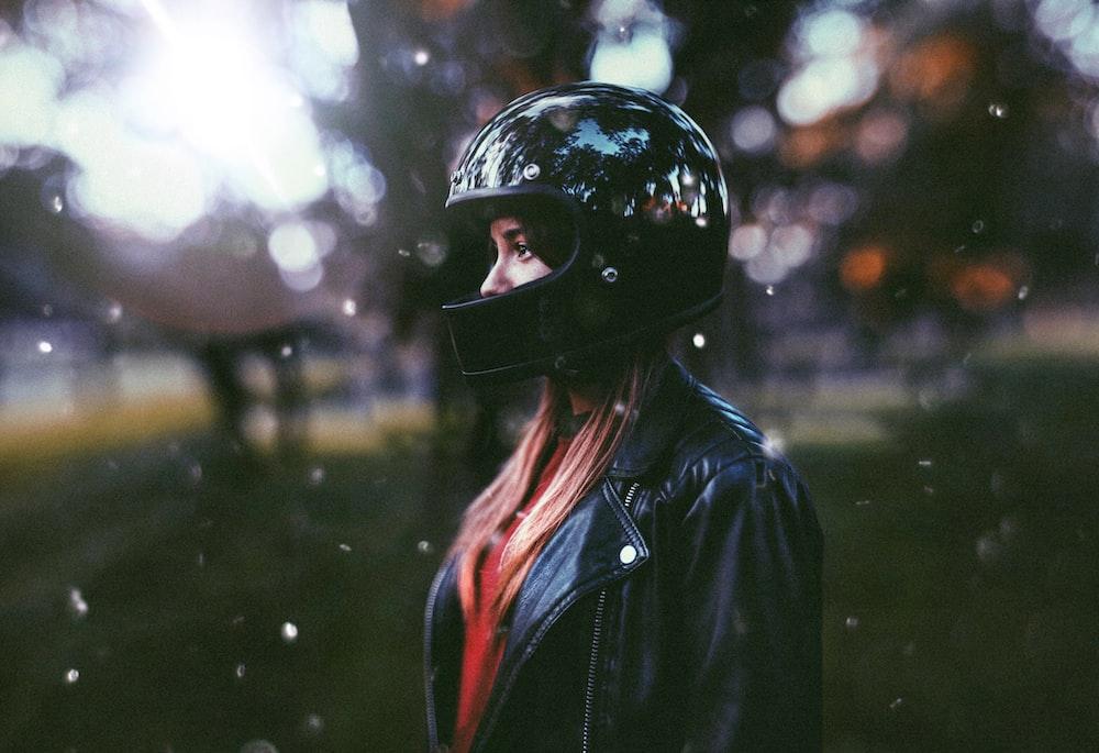 woman wearing black motorcycle helmet