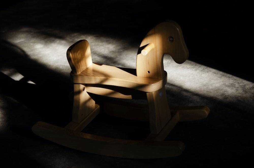 brown wooden rocking horse