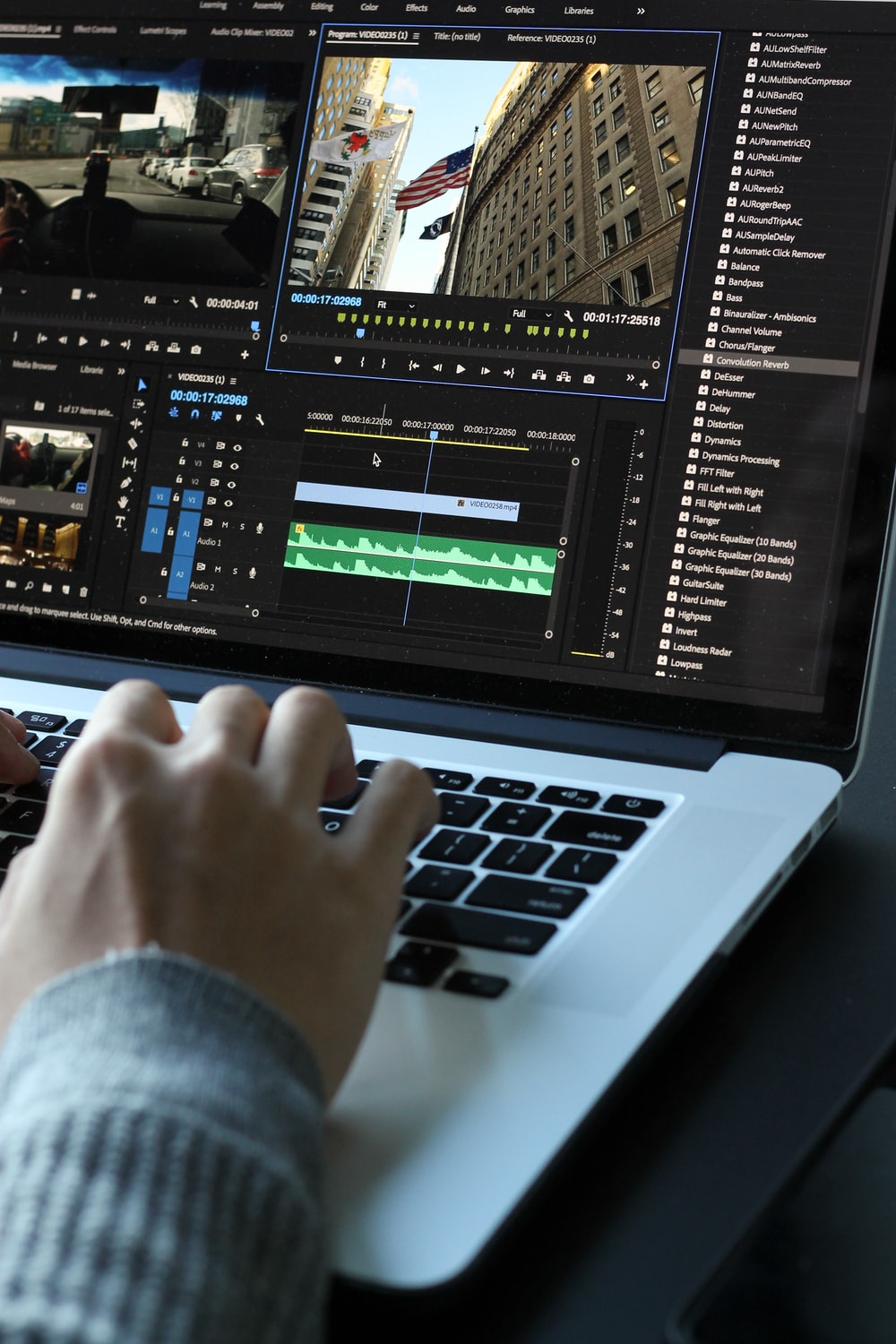 person using MacBook pro turned on