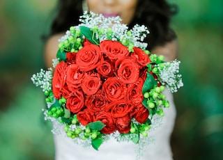red petaled flower bouquet