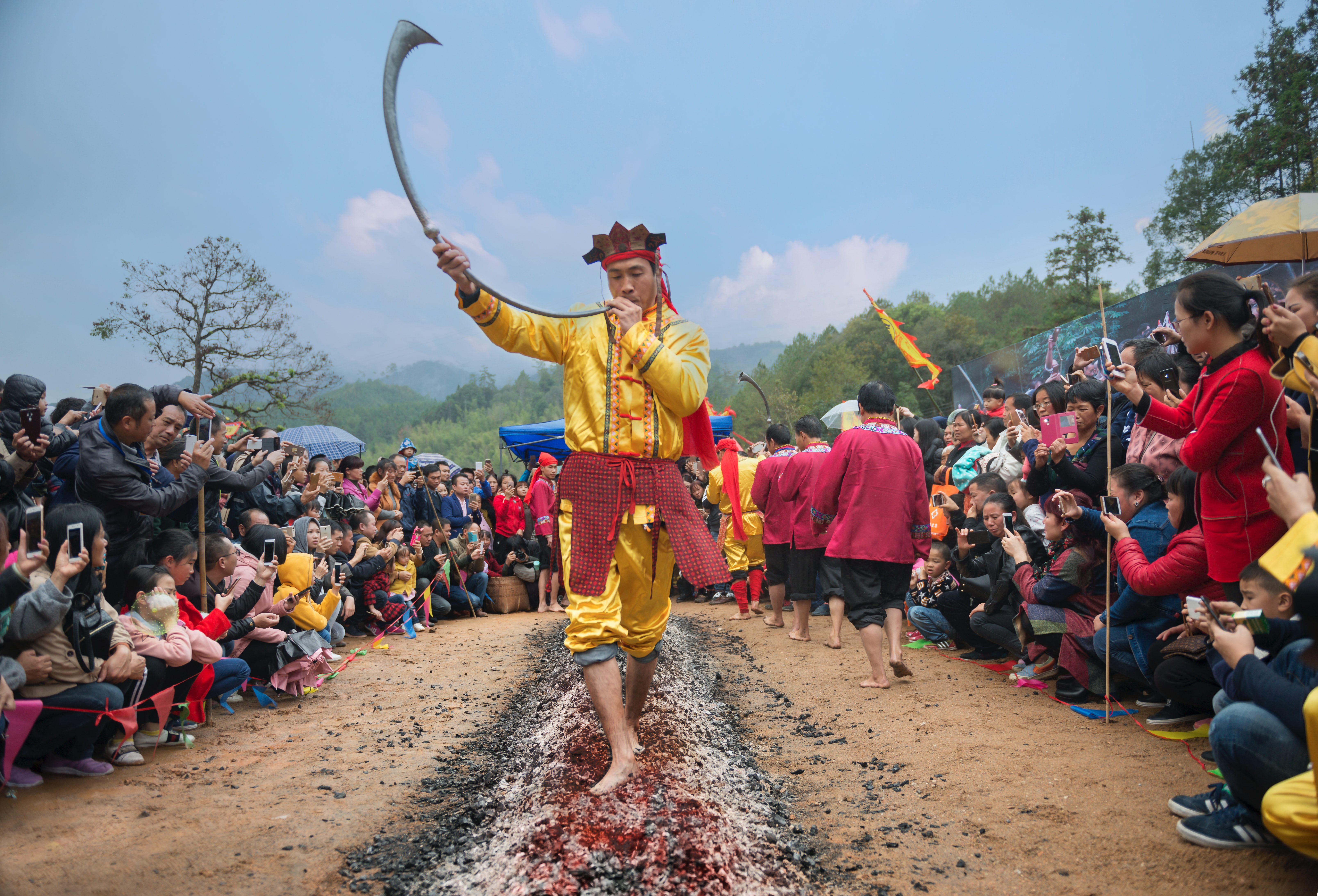 man performing traditional dance while holding sword