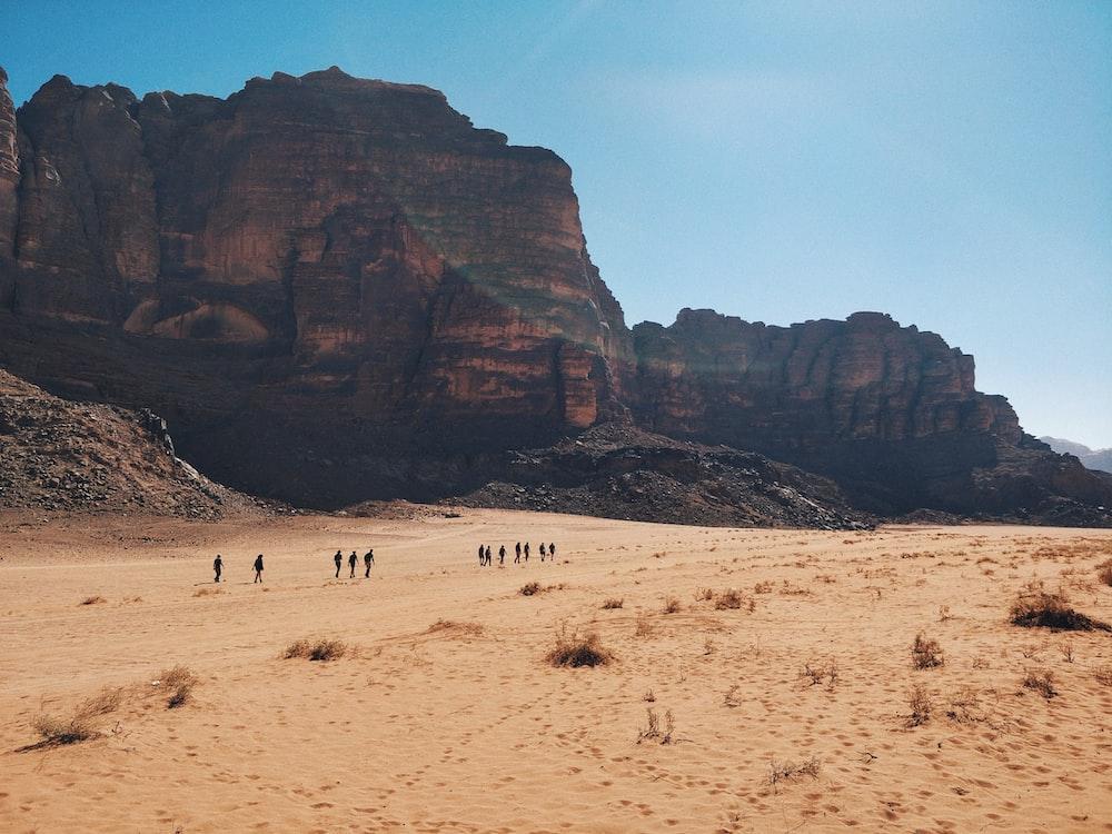 people walking on desert during daytime