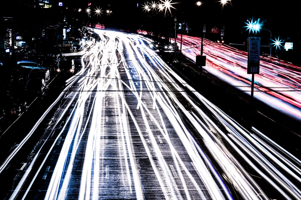 time lapse photography of vehicle passing during nighttime
