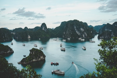 high-angle photography of boats on water near hill during daytime vietnam zoom background