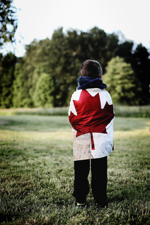 child wearing Canada flag