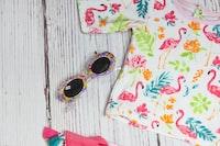 white and multicolored crew-neck shirt near sunglasses