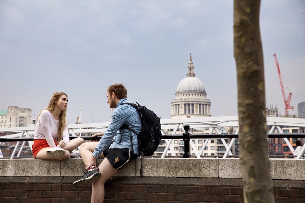 man and woman talking at the balcony