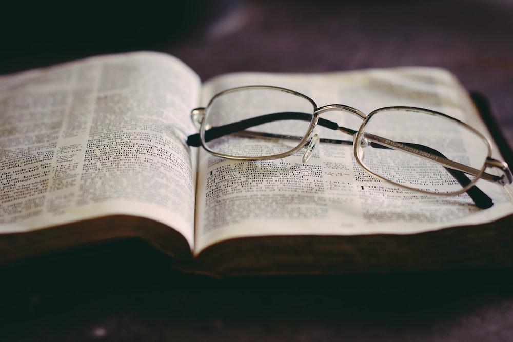 eyeglasses in top of book