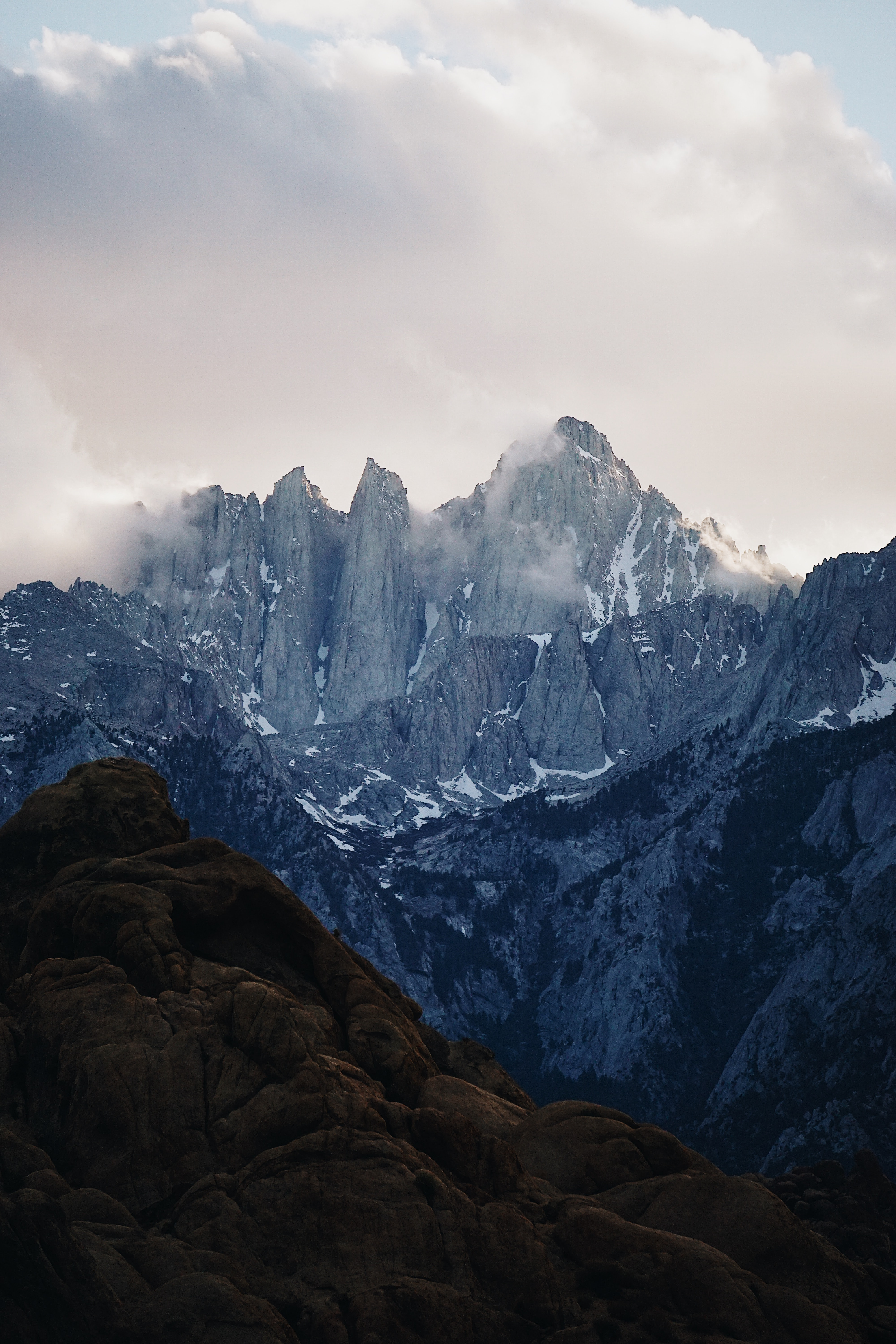 photo of gray mountains under cloudy sky
