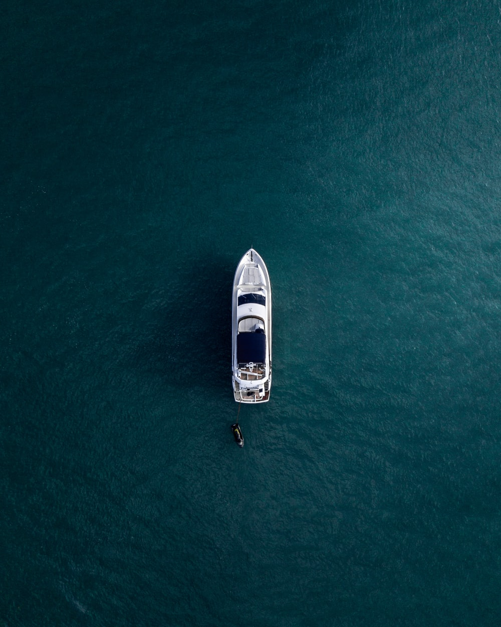 aerial photography of white yacht on calm waters