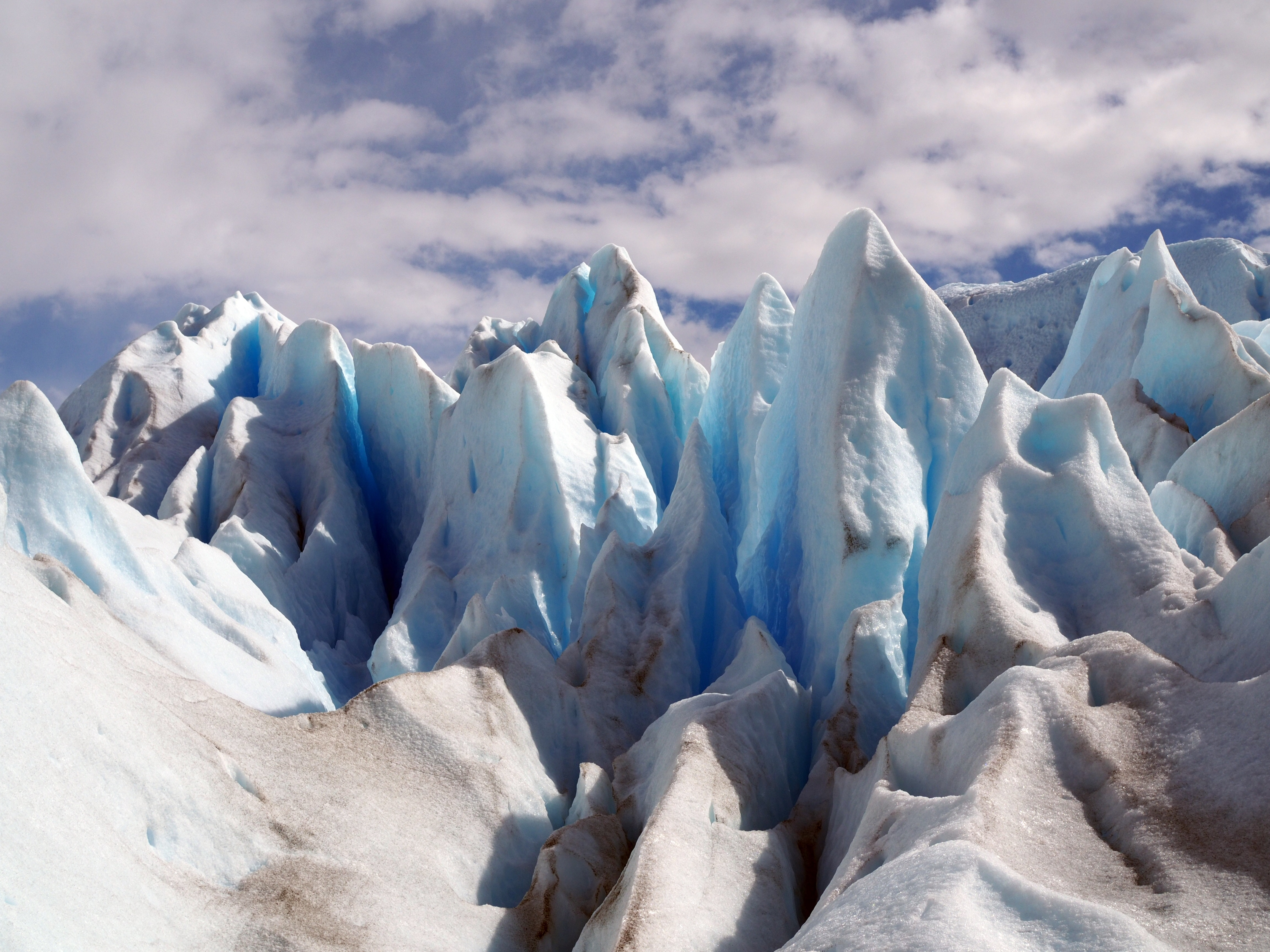 ice mountains under white clouds