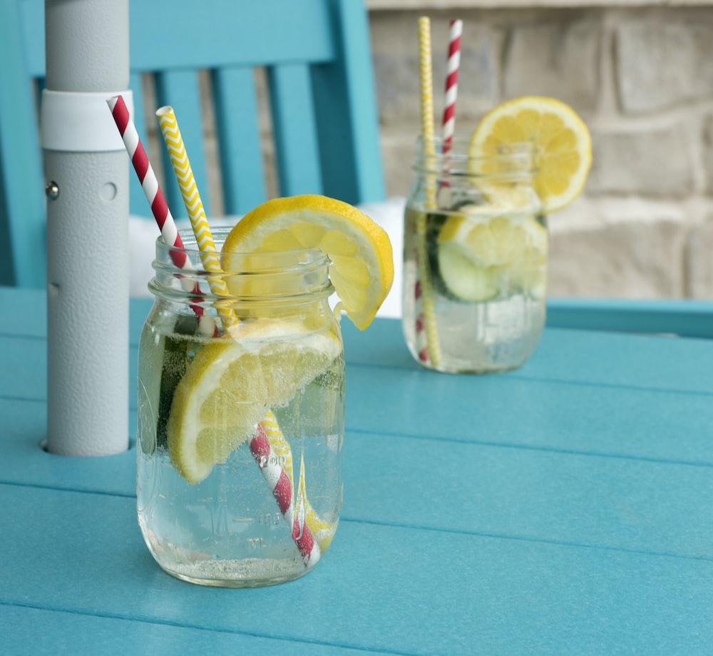 sliced lemon in clear glass jar