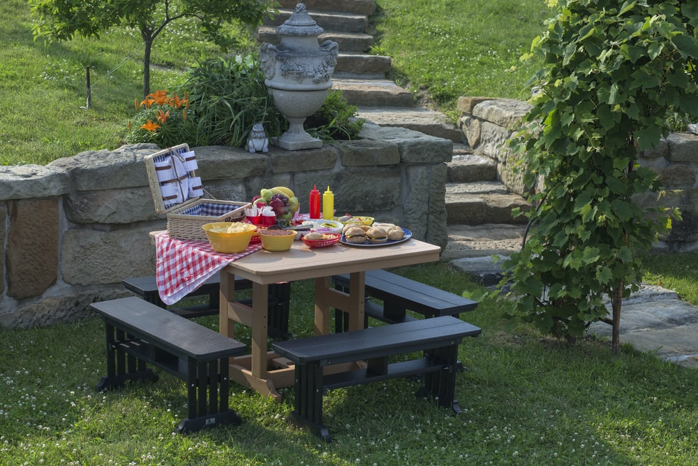 beige and black picnic table with variety of sandwiches prepared during daytime