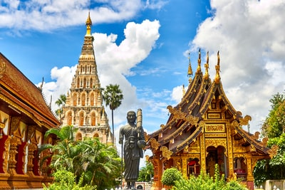 standing statue and temples landmark during daytime thailand teams background