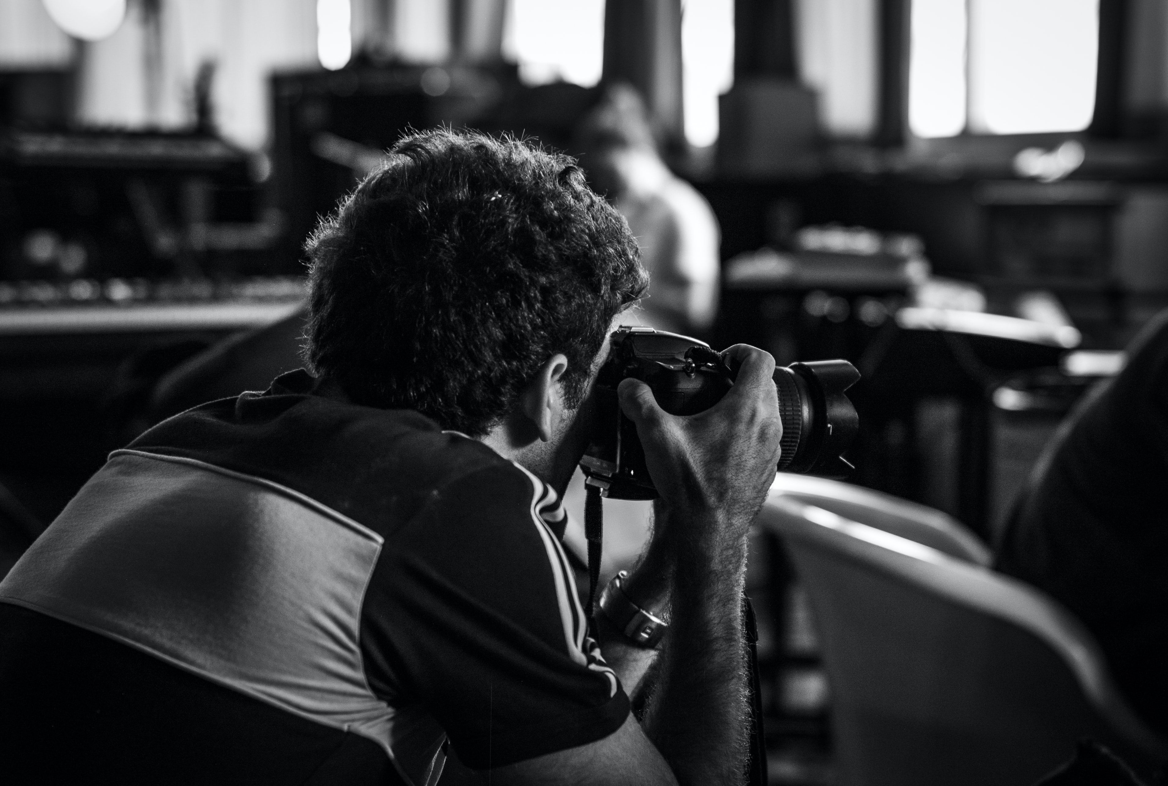 grayscale photography on man taking photos