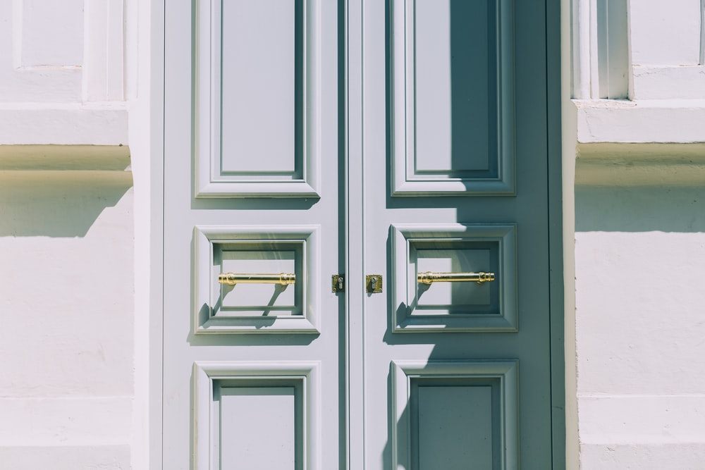 two white wooden doors