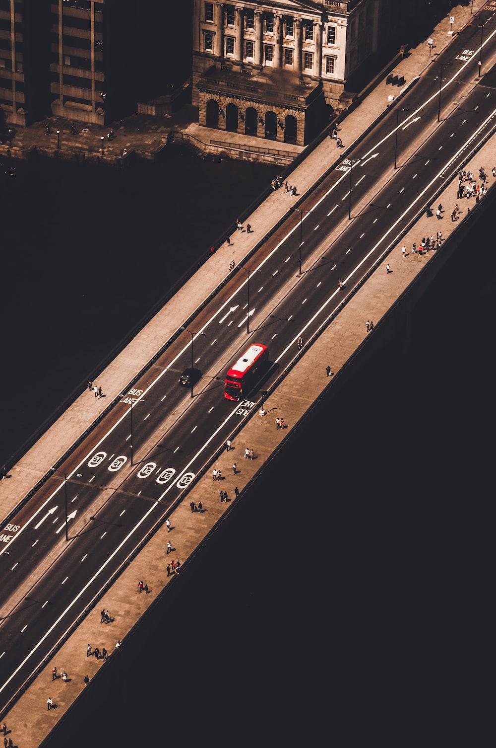 red and white bus running on bridge