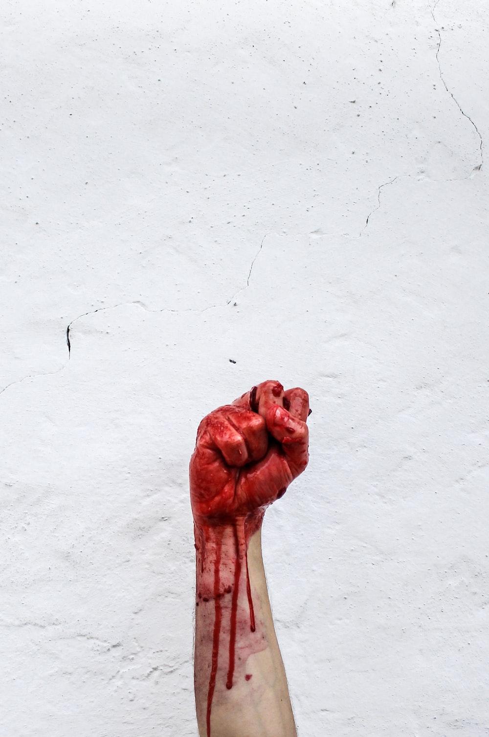 person raishing his hand