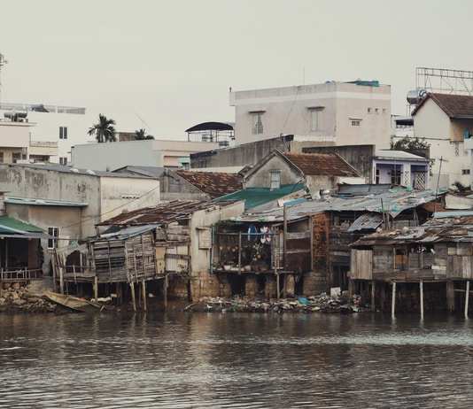 photo of houses near body of water